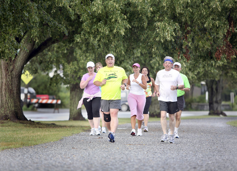 Roger Morse, front left, leads a group around Baxter Boulevard in Portland as they prepare for the Beach to Beacon, scheduled for Saturday in Cape Elizabeth.