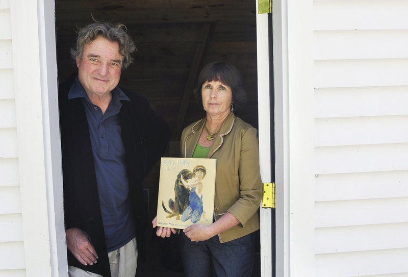 "Artist Jamie Wyeth and writer Barbara Walsh at Wyeth's home in Tenants Harbor with the new children's book they collaborated on, ""Sammy in the Sky,"" based on how Walsh's daughters dealt with the death of their dog."