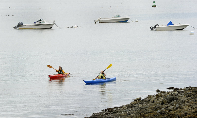 Nini McManamy of Portland and Sara Orbeton of South Portland kayak off East End Beach in Portland on Thursday morning.
