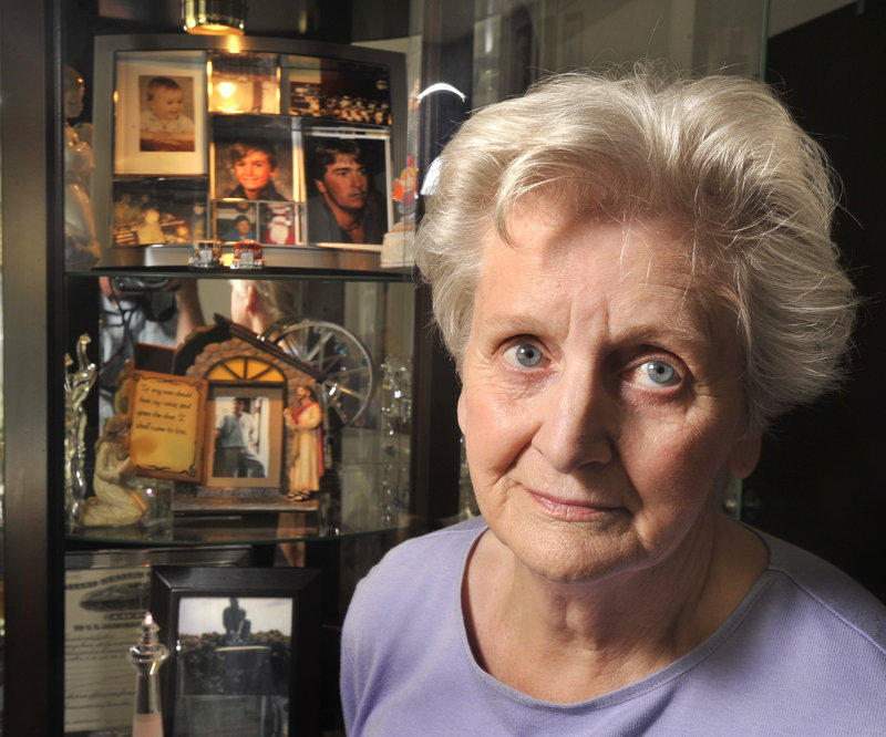 Shirley Doughty Horr of Portland has a 6-foot-tall glass case for displaying photos of her fisherman son, Mark Doughty, who died in a boat collision at sea 10 years ago. Horr's grief was so deep after the death of her youngest child that she remained in bed for months.