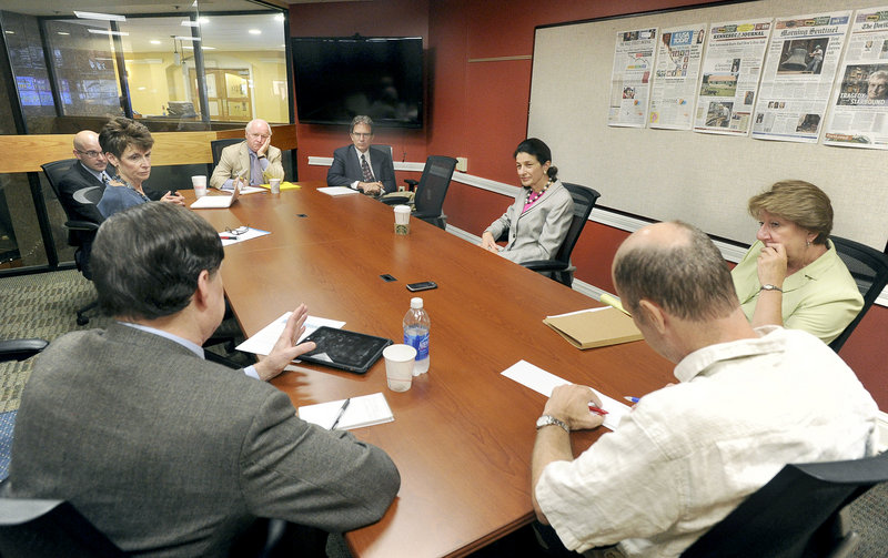U.S. Sen. Olympia Snowe visits MaineToday Media's editorial board Friday. Clockwise from lower left are Bill Thompson, editorial page director; Karen Dobbyn, vice president of Human Resources, Anthony Ronzio, editor and publisher of the Kennebec Journal and Morning Sentinel; Richard L. Connor, chairman and CEO; Greg Kesich, editorial writer; Snowe; Cheryl Leeman, a Snowe staffer; and Tom Bell, a MaineToday Media State House reporter.