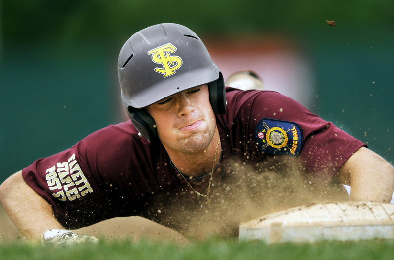 Sam Canales of Fayette-Staples dives safely back to first base during a 7-6 loss to Cranston, R.I., Friday in the American Legion Northeast Regional.