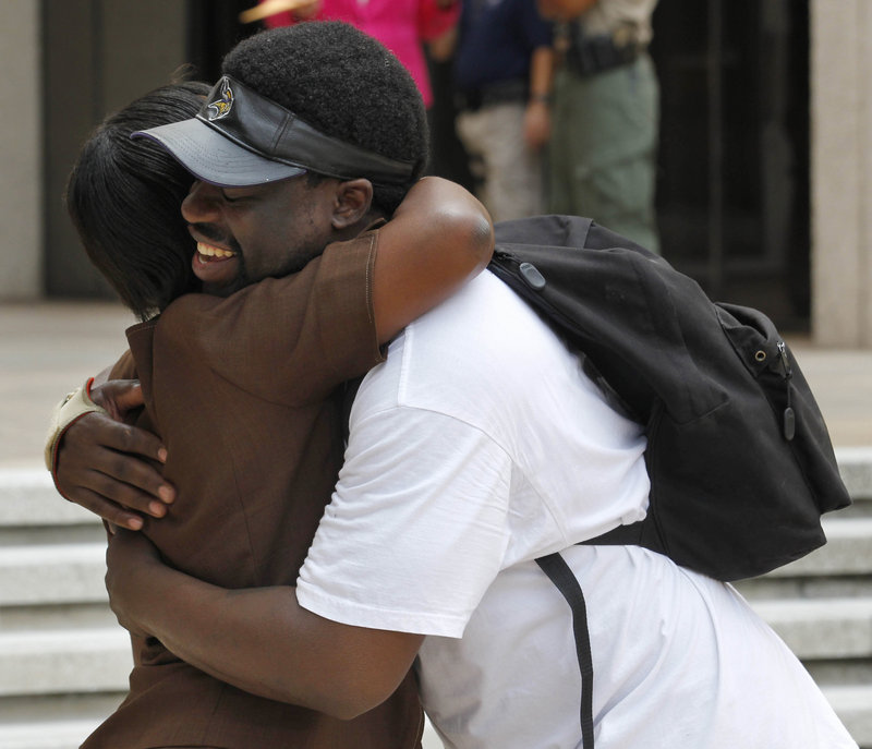 Unidentified supporters of victims and their families react outside federal court in New Orleans on Friday after five current or former police officers were convicted in the deadly shootings on a New Orleans bridge after Hurricane Katrina. The officers were convicted of charges stemming from the cover-up of the shootings.