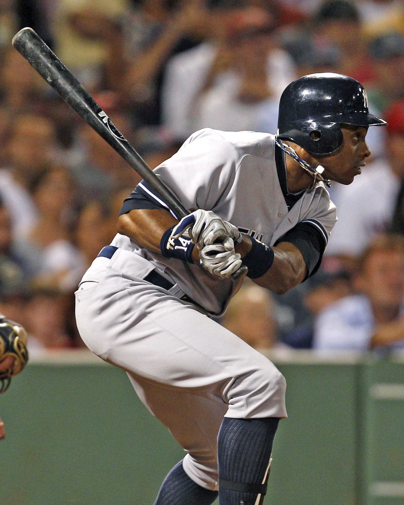 Curtis Granderson of the Yankees follows through with an RBI single in the sixth inning of the 3-2 victory Friday night against the Red Sox.