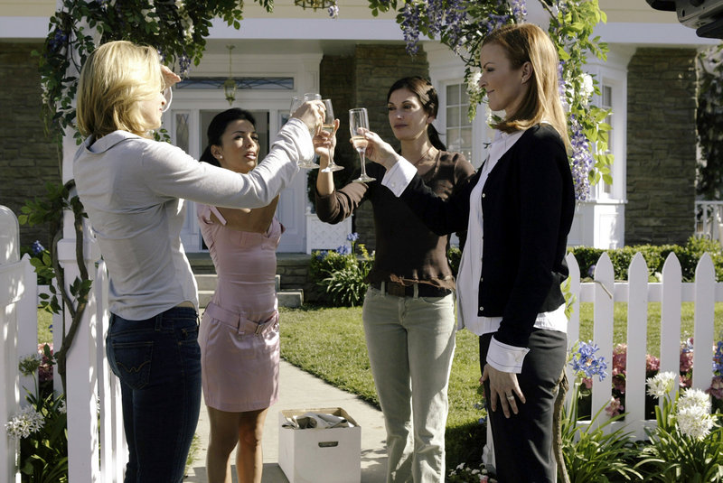 "From left, Felicity Huffman, Eva Longoria, Teri Hatcher and Marcia Cross toast one another in a scene from ABC's ""Desperate Housewives."" According to a person familiar with ABC's plans for the drama – which debuted in 2004 – the end is near for the pop icon."