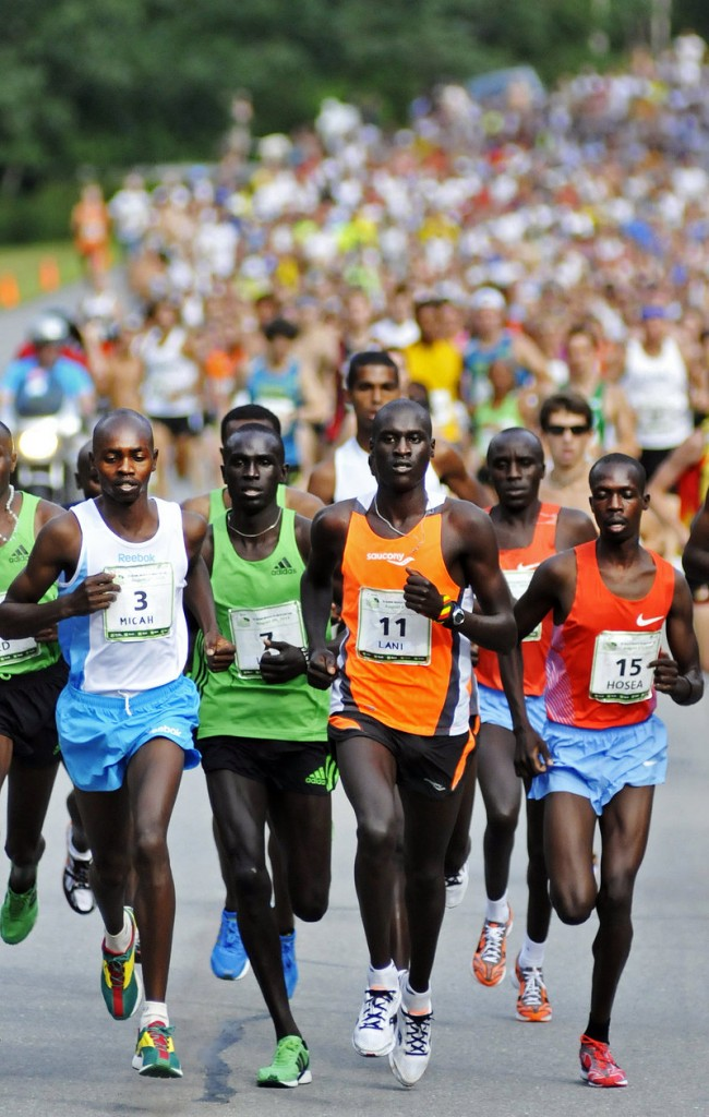 Off they go Saturday, the elite runners in front for the Beach to Beacon 10K in Cape Elizabeth. Included in the lead pack are, from left to right, Micah Kogo (the winner), Lucas Rotich, Lani Rutto and Hosea Mwok-Macharinyang, all of Kenya.