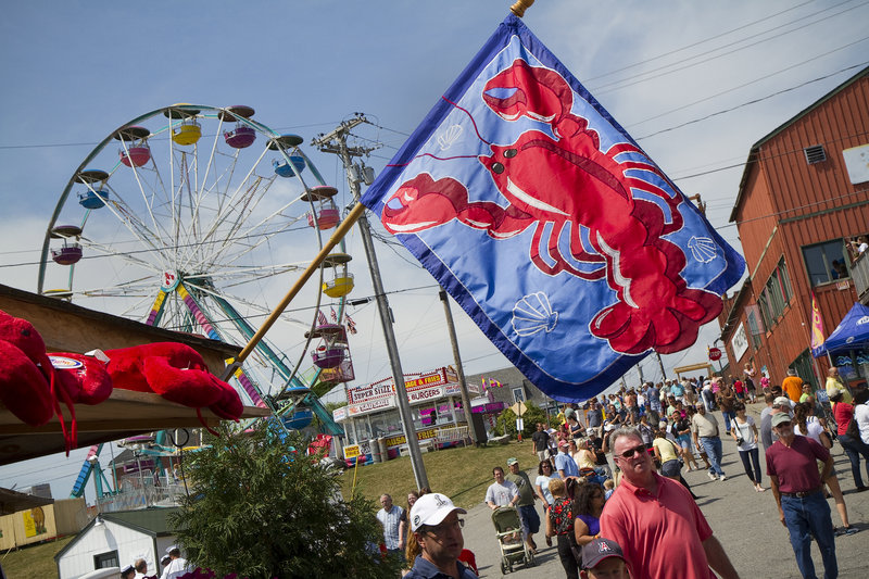 Harbor Park exudes a festive air with carnival rides and food vendors.