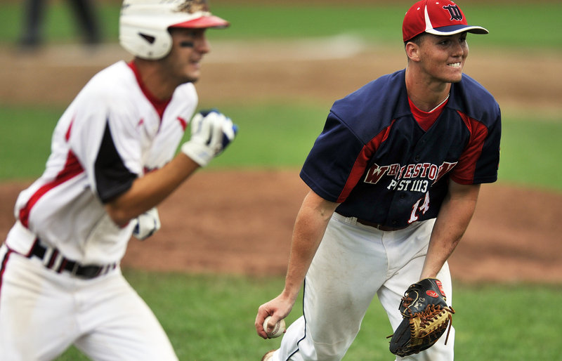 Whitestown pitcher Daniel Smith prepares to flip the ball to first base to retire a Norwalk batter. Whitestown will play Bedford, N.H., in today's championship round.