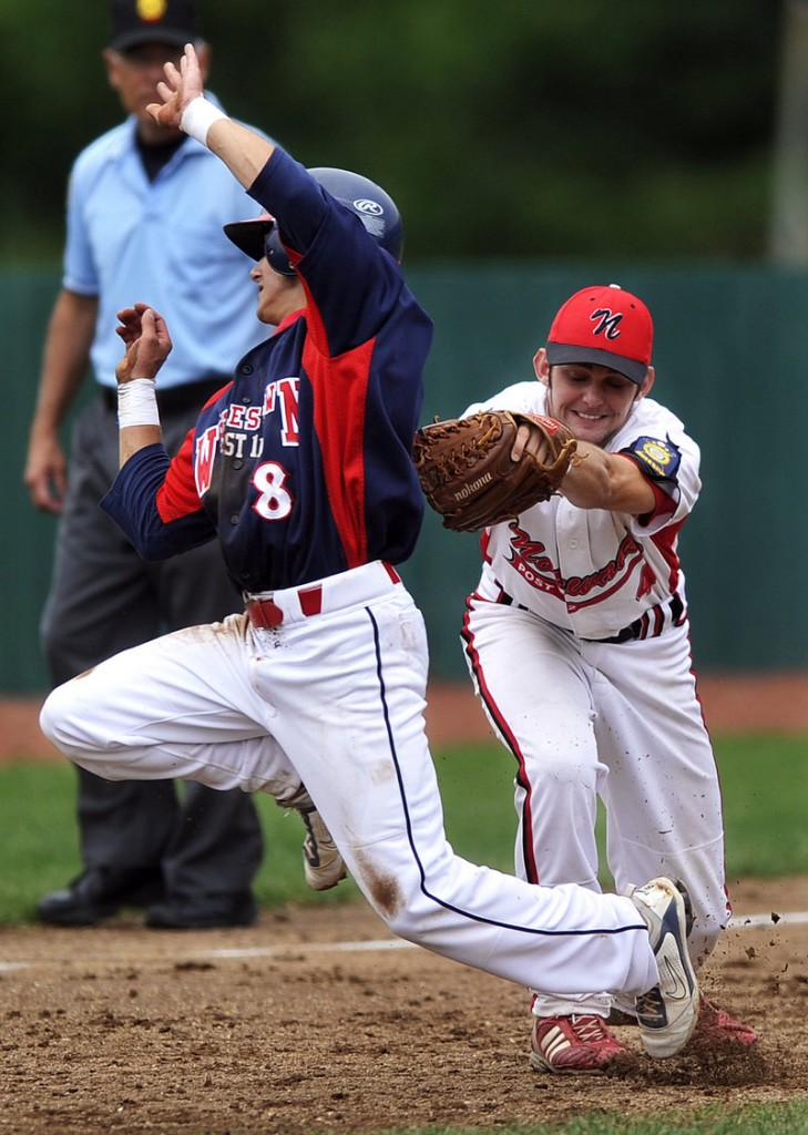 Adam Pexton of Whitestown, N.Y., can't avoid the tag by Patrick Donohue of Norwalk, Conn. Whitestown advanced to the regional finals with a 9-5 victory.