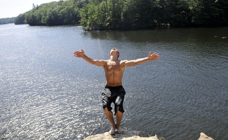 Matt LeBlanc of Dayton jumps into the Saco River in Buxton on July 22, when the temperature in Portland hit 100 degrees.