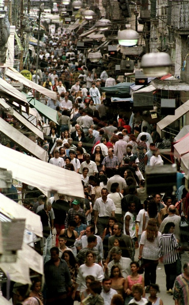 Shoppers fill a street closed to traffic in Rio de Janeiro, Brazil, where the middle class is growing. Multinational companies are investing in countries like Brazil, China and India in part because of their thriving consumer spending.