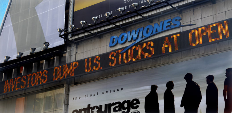 A Dow Jones news ticker in Times Square displays investor reaction Monday to a downgrade of the nation's credit rating by Standard & Poor's and the anemic economic recovery. Asian markets slumped again early today.