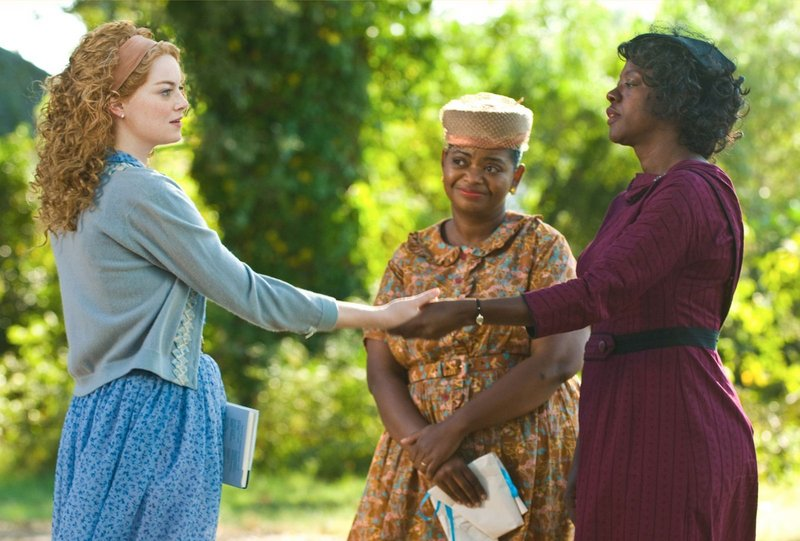 Skeeter Phelan (Emma Stone, left), Minnie Jackson (Octavia Spencer, center) and Aibileen Clark (Viola Davis) together take a risk that could have profound consequences for them all in