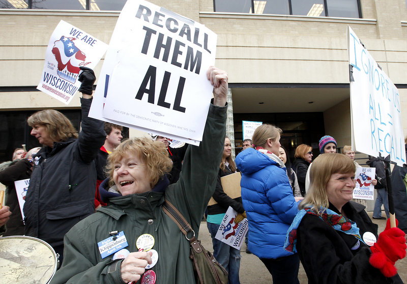 Demonstrators call for the recall of Republican state Sen. Dan Kapanke outside the Wisconsin Government Accountability Board in Madison, Wis., earlier this year.