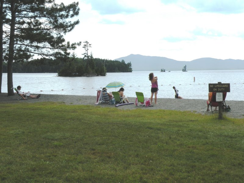 The beach at Lily Bay State Park looks across Moosehead Lake to Big Moose Mountain. The park offers camping, fine hiking trails and great wildlife watching.