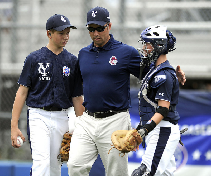 Yarmouth Manager Jay Tobias, center, meets at the mound with pitcher Luke Klenda and catcher Grant Tobias during Tuesday's game at the Little League regionals.