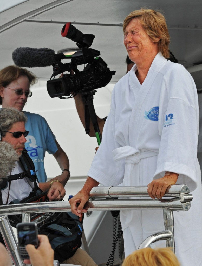 Diana Nyad cries as she speaks to reporters and fans after arriving back in Key West on Tuesday after her attempt to swim from Cuba failed.