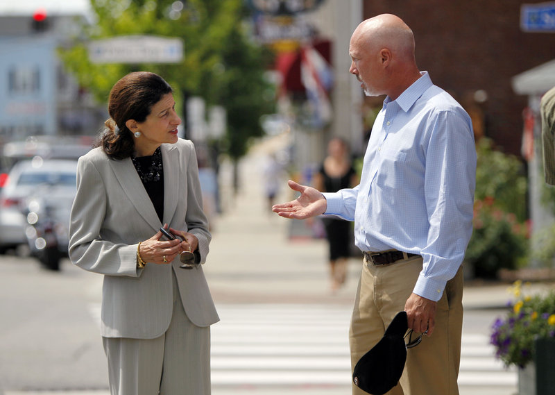 "Sen. Olympia Snowe speaks with Ian Engleman of Scarborough in Saco on Tuesday. She told one restaurant owner, ""I've never seen a worse Congress in my whole political life."""