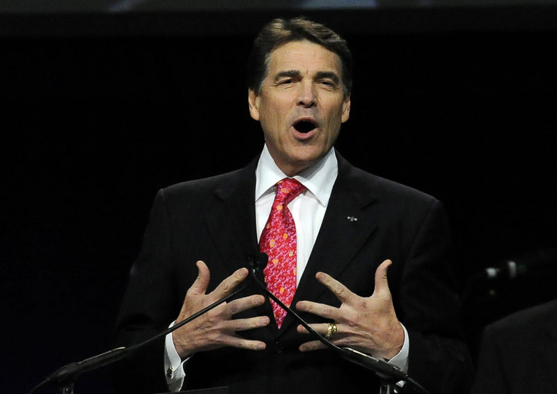 Gov. Rick Perry speaks at a national prayer rally last week in Houston. Secular groups have criticized him, saying his rhetoric violates the separation of church and state.