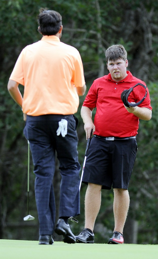 Ryan Gay, right, is approached by Matt Greenleaf as Greenleaf concedes on the 16th hole of the final round of MSGA match play at the Augusta Country Club in Manchester.