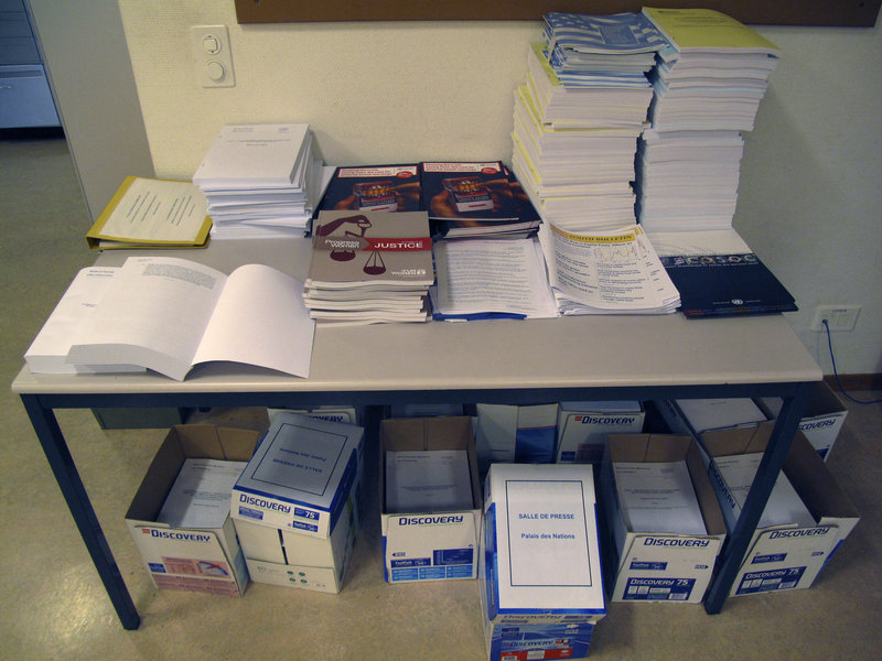 Files and documents pile up in a United Nations office at the Palais des Nations in Geneva, Switzerland. The U.N. is putting a word limit on reports because of the cost of reproducing and translating them.