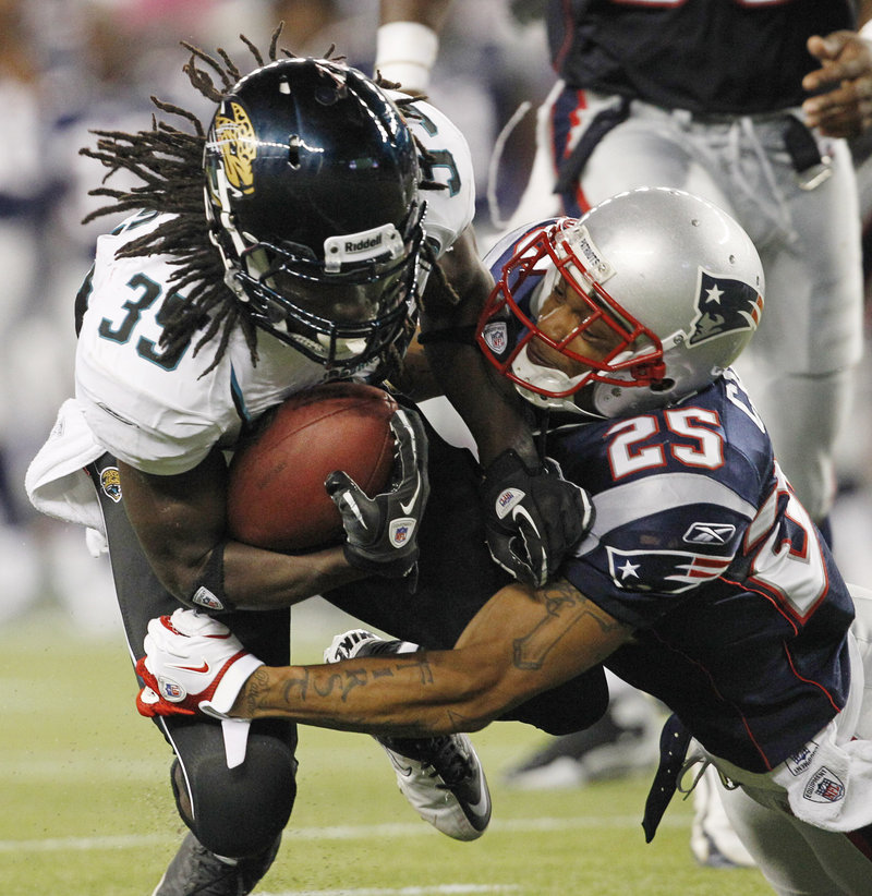 Jacksonville Jaguars running back Deji Karim, left, gets a hearty welcome from New England Patriots safety Pat Chung in the second quarter of their NFL preseason game in Foxborough, Mass., on Thursday night. The Patriots' backup quarterbacks looked impressive in the team's 47-12 victory.