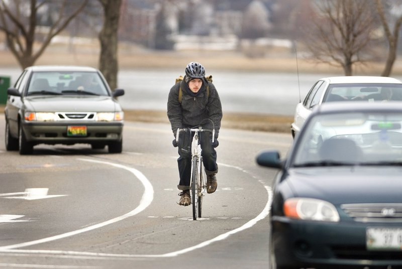 A cyclist uses the bike lane on Portland's Baxter Boulevard. What happens when no such lane exists?
