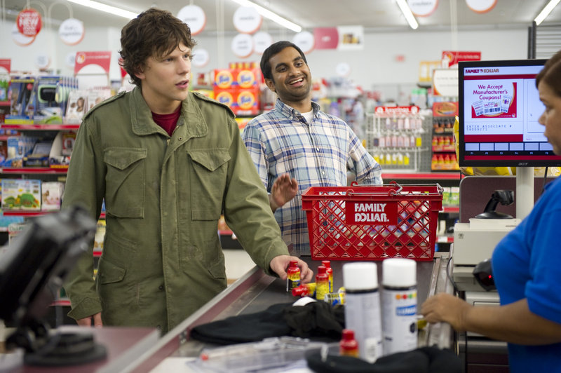 "Jesse Eisenberg, left, and Aziz Ansari click as buddies – Eisenberg a deliveryman forced to rob a bank, Ansari a schoolteacher – in ""30 Minutes or Less."""