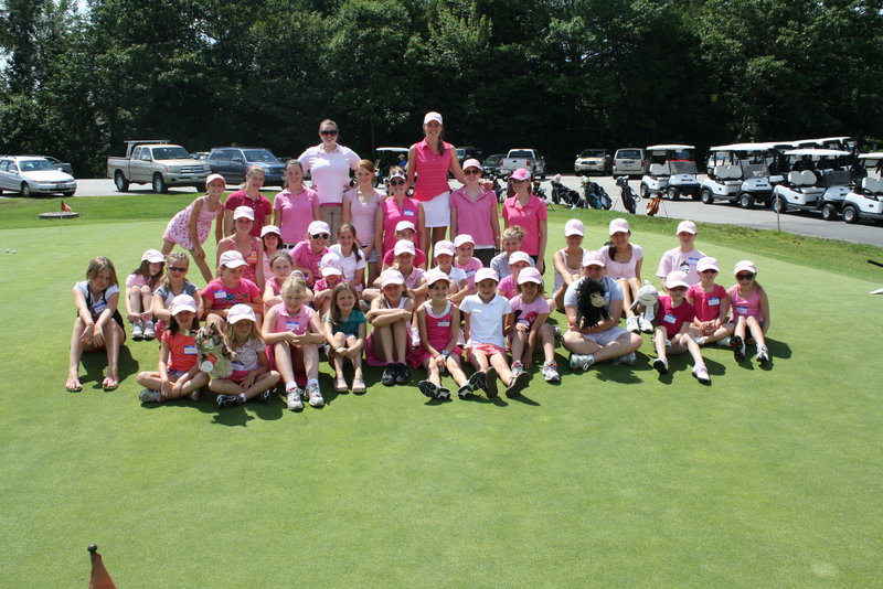 This is a photo of the campers with their instructors. Left to right: Katie Whittum (back row, second from left), Edith Aromando, Maura Quigley, Laura Grant, Shannon Mitchell, Meghan Bickford, Megan Hudson, Sarah Hansen. They are all instructors at Megha' s Camp and are pictured on Pink Thursday with the kids.