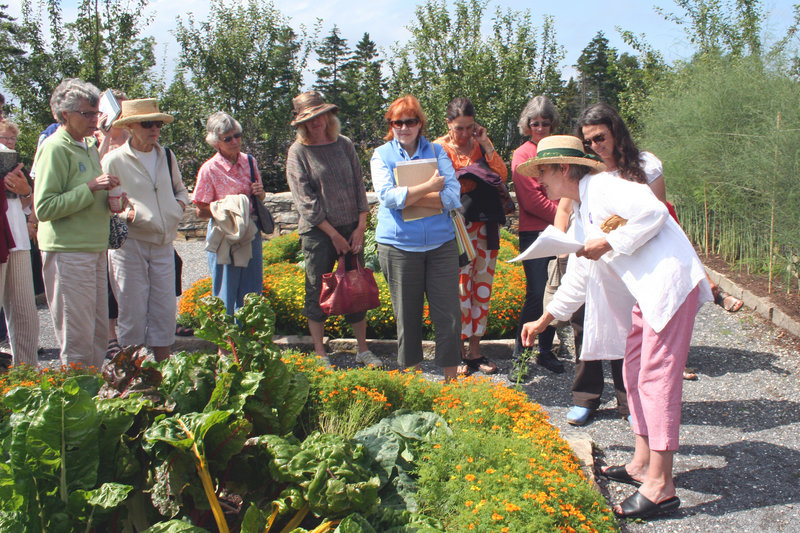 Nancy Wetzel of the Sarah Orne Jewett House leads a recent program on herbs at Coastal Maine Botanical Gardens.