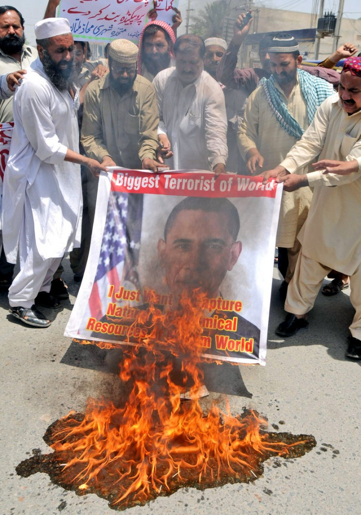 Activists of a local social group Muthahida Shehri Mahaz burn a banner depicting U.S. President Barack Obama during a rally to condemn the killing of al-Qaida leader Osama bin Laden, in Pakistan on May 8. The U.S. can't be complacent about terror threats.
