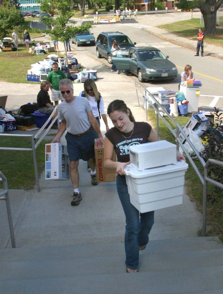 A student moves into a dorm at the University of Southern Maine in this file photo.