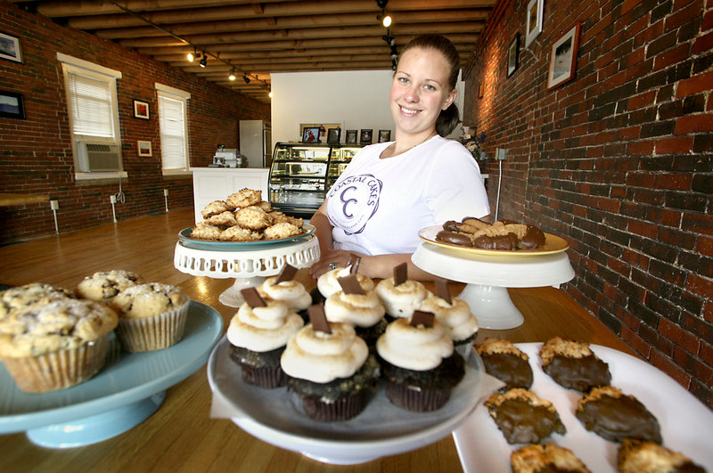 Vicki Pettinger, owner of Coastal Cakes, shows off some of the products available in her new store in Saco. She decided to rent space in Pepperell Square, just off Main Street, to help keep costs at a minimum.