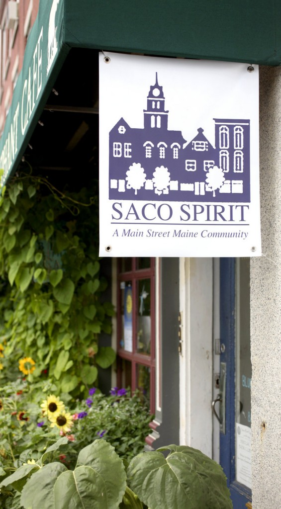 A sign supporting downtown Saco hangs near the Blue Elephant Cafe on Pepperell Square, just off Main Street.