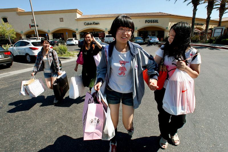 Cherry Cui, from left, Jane Zhu, Mamie Chan and Tequila Song hit Camarillo Premium Outlets in Camarillo, Calif., during their trip from Shanghai last month.