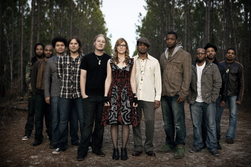 Tedeschi Trucks Band, led by Susan Tedeschi on guitar and vocals and Derek Trucks on guitar, includes bassist Oteil Burbridge and keyboardist/flutist Kofi Burbridge, drummers J. J. Johnson and Tyler Greenwell, trumpeter Maurice Brown, tenor saxophonist Kebbi Williams, trombonist Saunders Sermons, and harmony singers Mark Rivers and Mike Mattison.