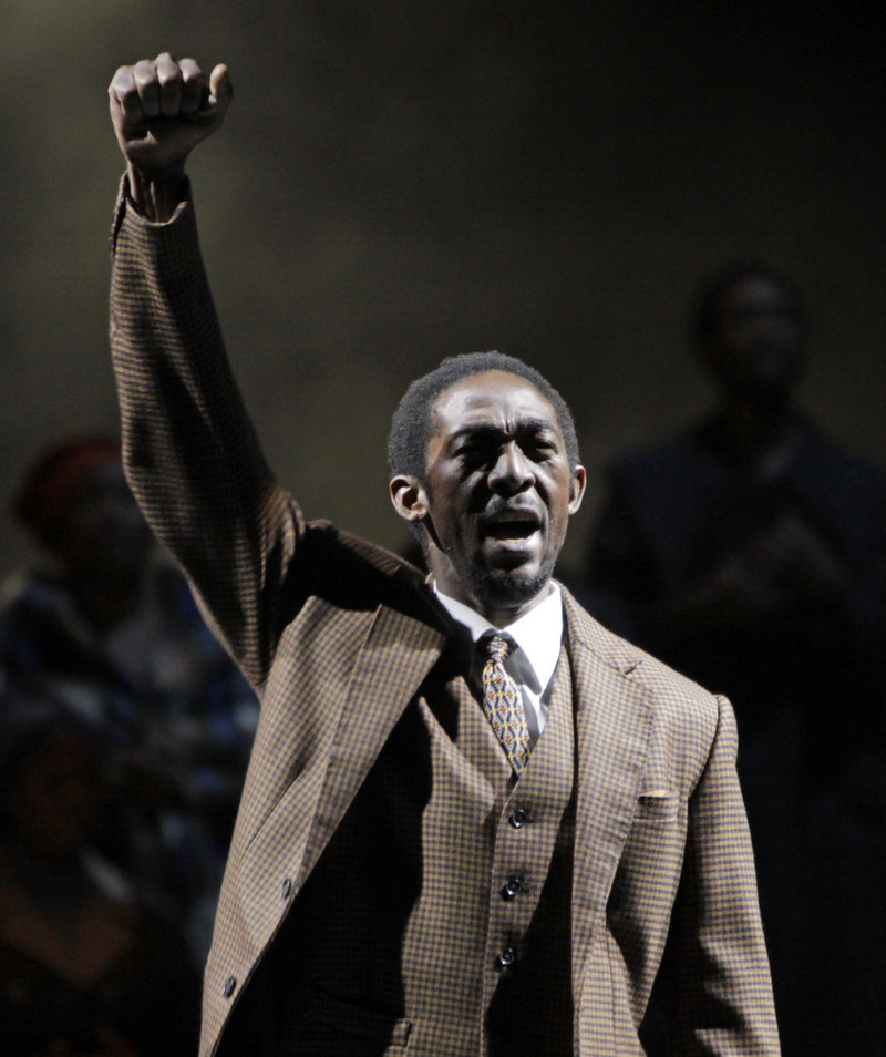 "Aubrey Lodewyk plays Nelson Mandela giving a black power salute at the end of Mandela's treason trial during a dress rehearsal of the new opera ""Mandela Trilogy"" in Johannesburg on Friday."