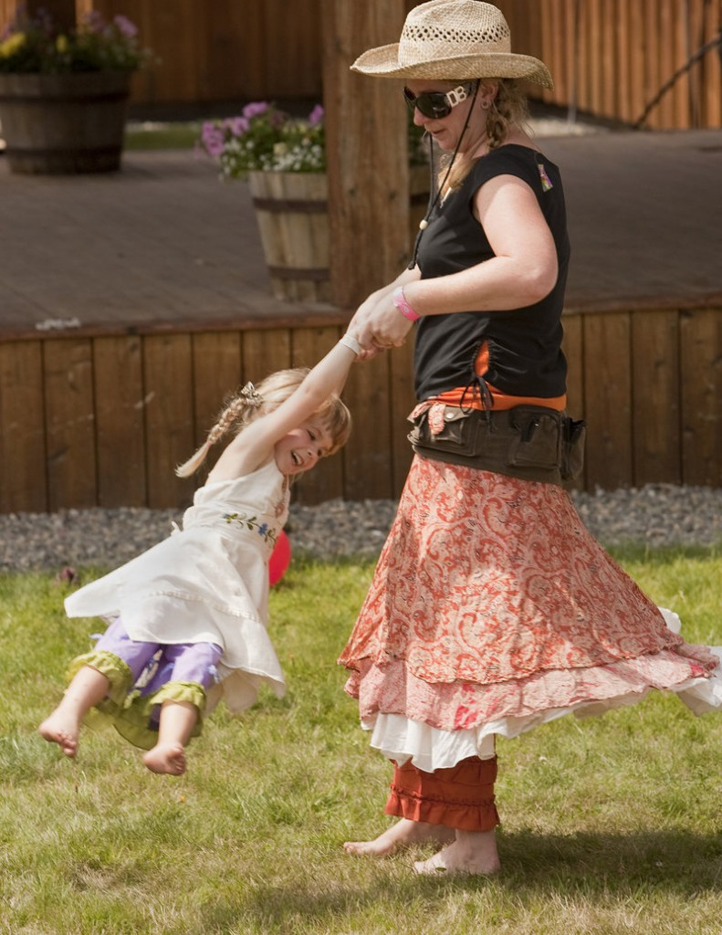 Christine Stout of Jefferson swings her 3-year-old daughter Jade while dancing to a tune at the Saddleback Mountain Bluegrass Festival.