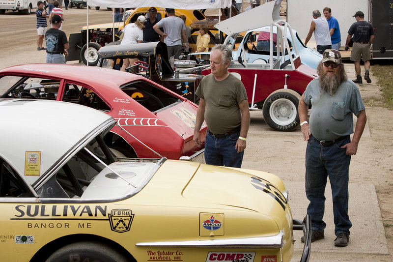 Darrell Flanders of New Gloucester and Joe Espeaignette of Windham check out cars on display at Sunday's Maine Vintage Race Car Association event.