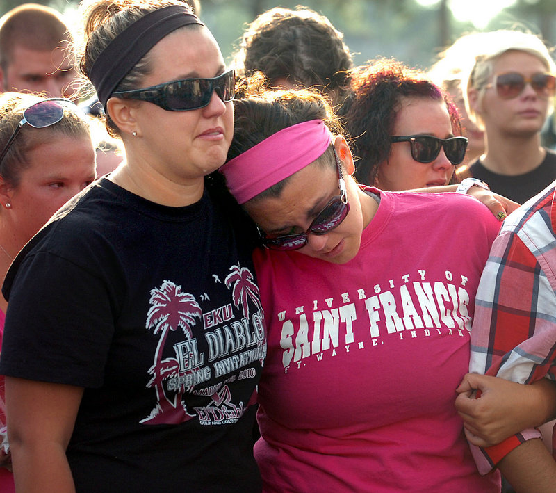 Nikki LeRose, left, and Kelsea Jackson remember their friend Alina Bigjohny at a memorial gathering at Wayne High School in Fort Wayne, Ind., on Sunday. Bigjohny, 23, a 2007 graduate of Wayne, was killed Saturday night in the stage collapse at the Indiana State Fair.