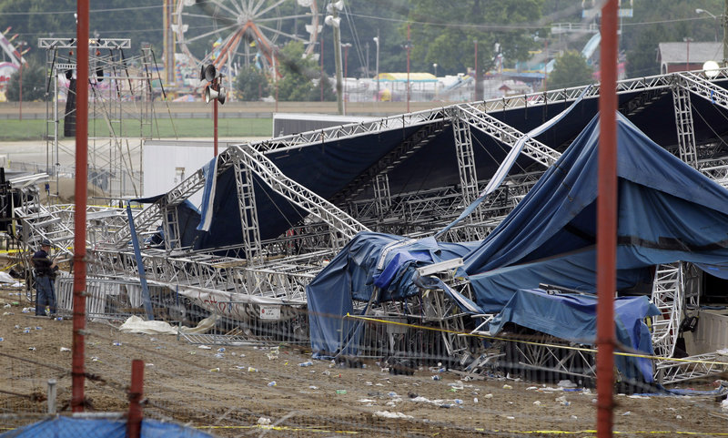 Indiana authorities survey the collapsed rigging and stage on the infield at the Indiana State Fair in Indianapolis on Sunday. Five people died in the stage collapse.