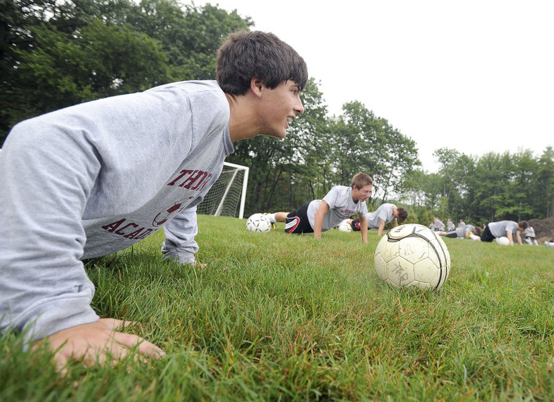 Monday's focus was conditioning, which is why Thornton Academy's Devon Vervelle was enjoying so many pushups in the wet grass in Saco.