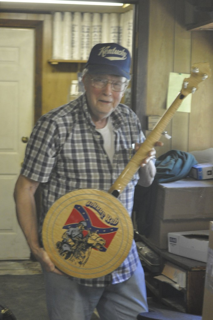 Jimmy Cox holds one of his hand-made Johnny Reb banjos. He made a limited edition of 20, one for each commander in the Confederate Army.