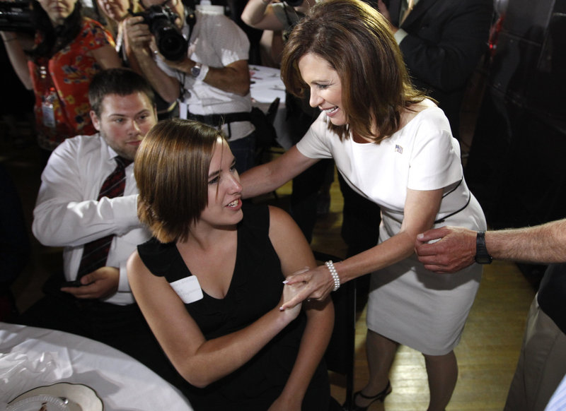 Michele Bachmann shakes hands Sunday in Iowa. She has established herself as a more serious GOP candidate than many believed possible.