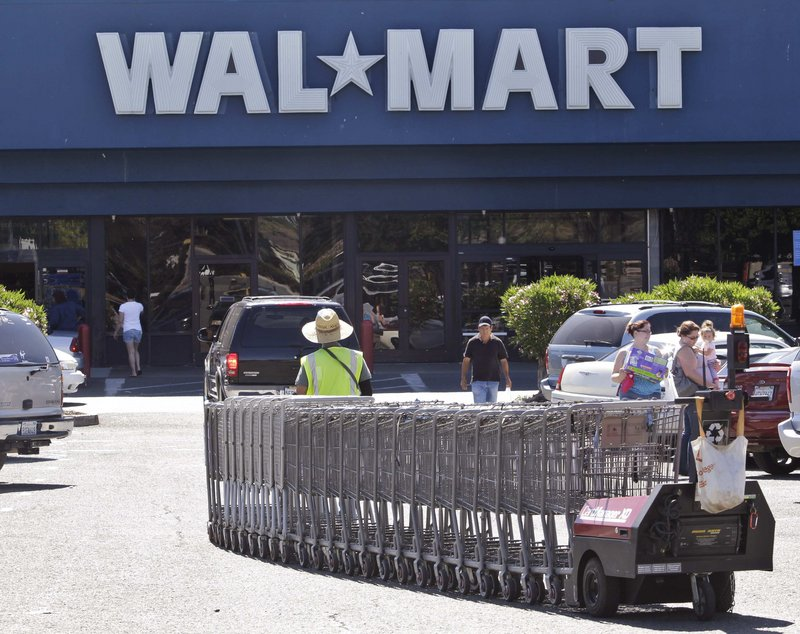 Walmart's second-quarter profit rose 5.7 percent, fueled by strong international sales growth and cost cutting.