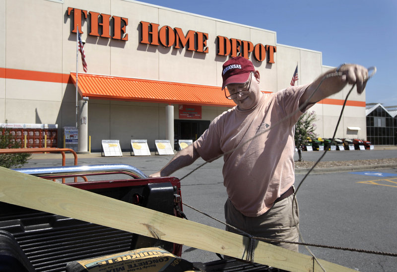 Home Depot's second-quarter profit rose 14 percent, as shoppers picked up lawn and garden products and made storm-related repairs. Meanwhile, consumer sentiment hit a 31-year low this month.