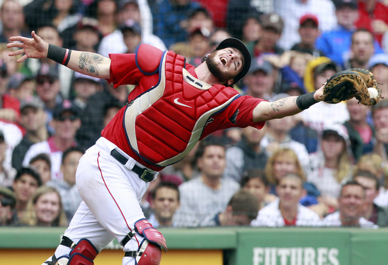 Red Sox catcher Jarrod Saltalamacchia stretches Tuesday to haul in a pop foul by Kelly Shoppach of Tampa Bay in the seventh inning of the first game at Fenway Park. Boston won the opener 3-1 before Tampa Bay came back to a 6-2 victory in the second game.