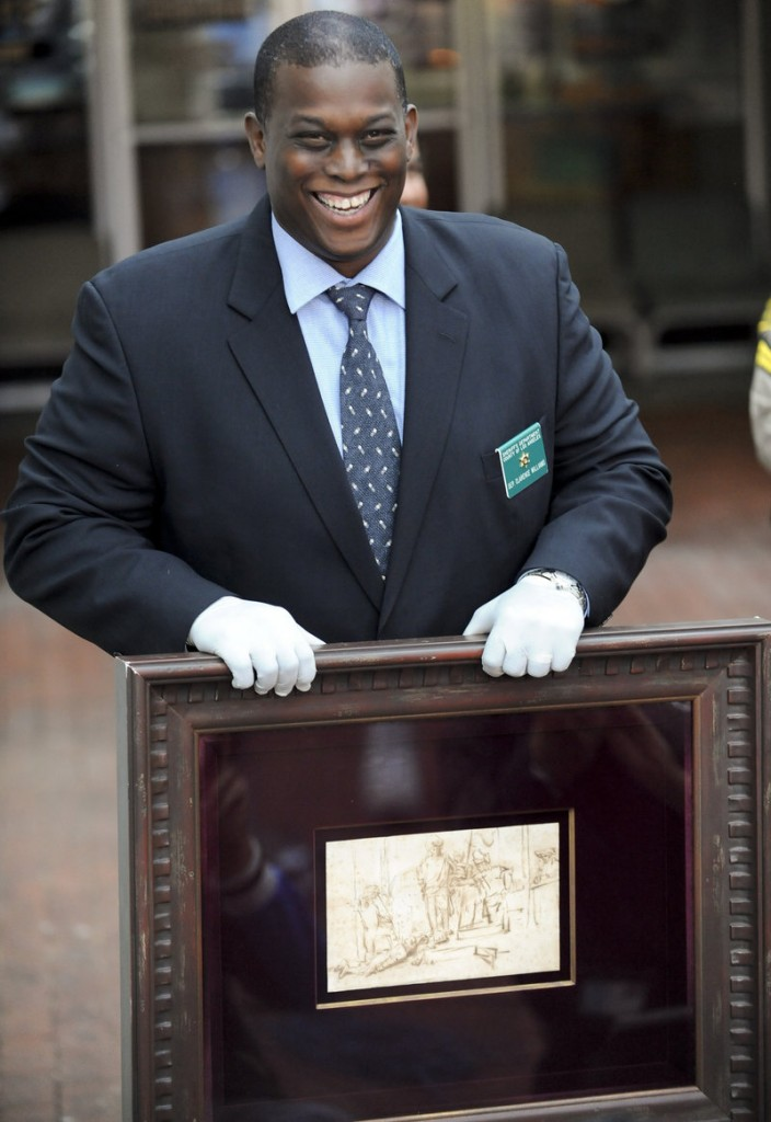 """Detective Clarence Williams displays the recovered $250,000 Rembrandt pen-and-ink drawing known as """"The Judgment"""" at a news conference Tuesday in Marina del Rey, Calif."""