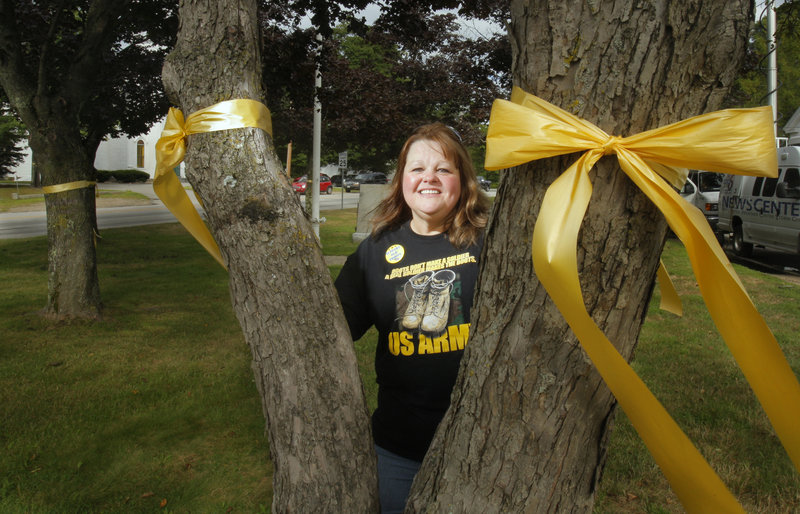 Susan Babb-McKinney wants to keep putting yellow ribbons on village green trees, but Alfred selectmen may decide to limit the practice.