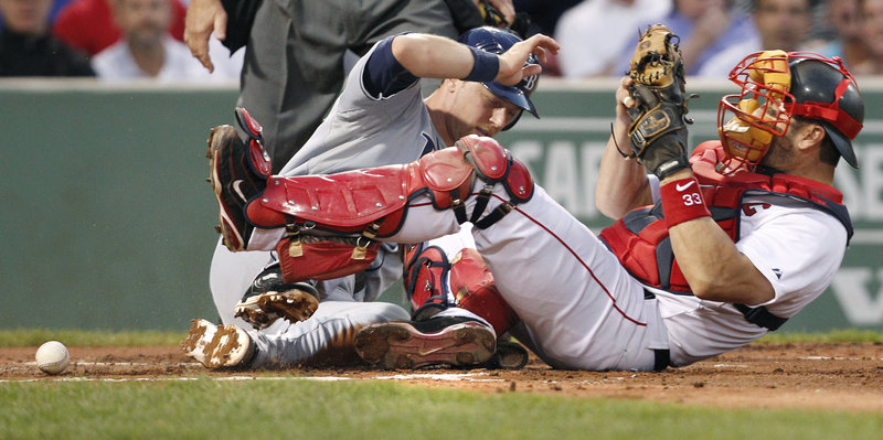 Red Sox catcher Jason Varitek fails to hold onto the ball as Ben Zobrist of the Tampa Bay Rays slides safely home to score on Sean Rodriguez's grounder in the nightcap.